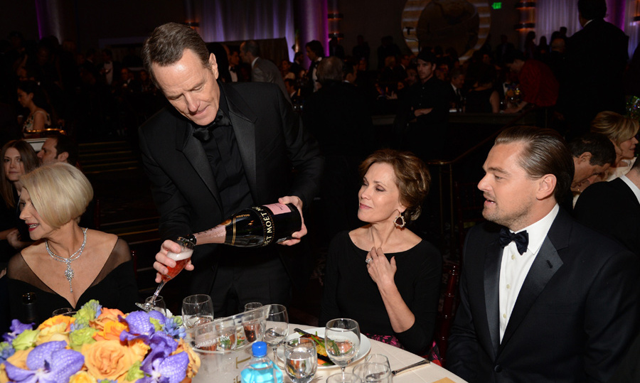Bryan Cranston kept the champagne flowing at Leonardo DiCaprio and Helen Mirren's table. 