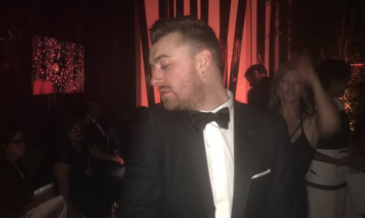 Sam Smith let his hair down on the dancefloor after winning the trophy for Best Original Song.
