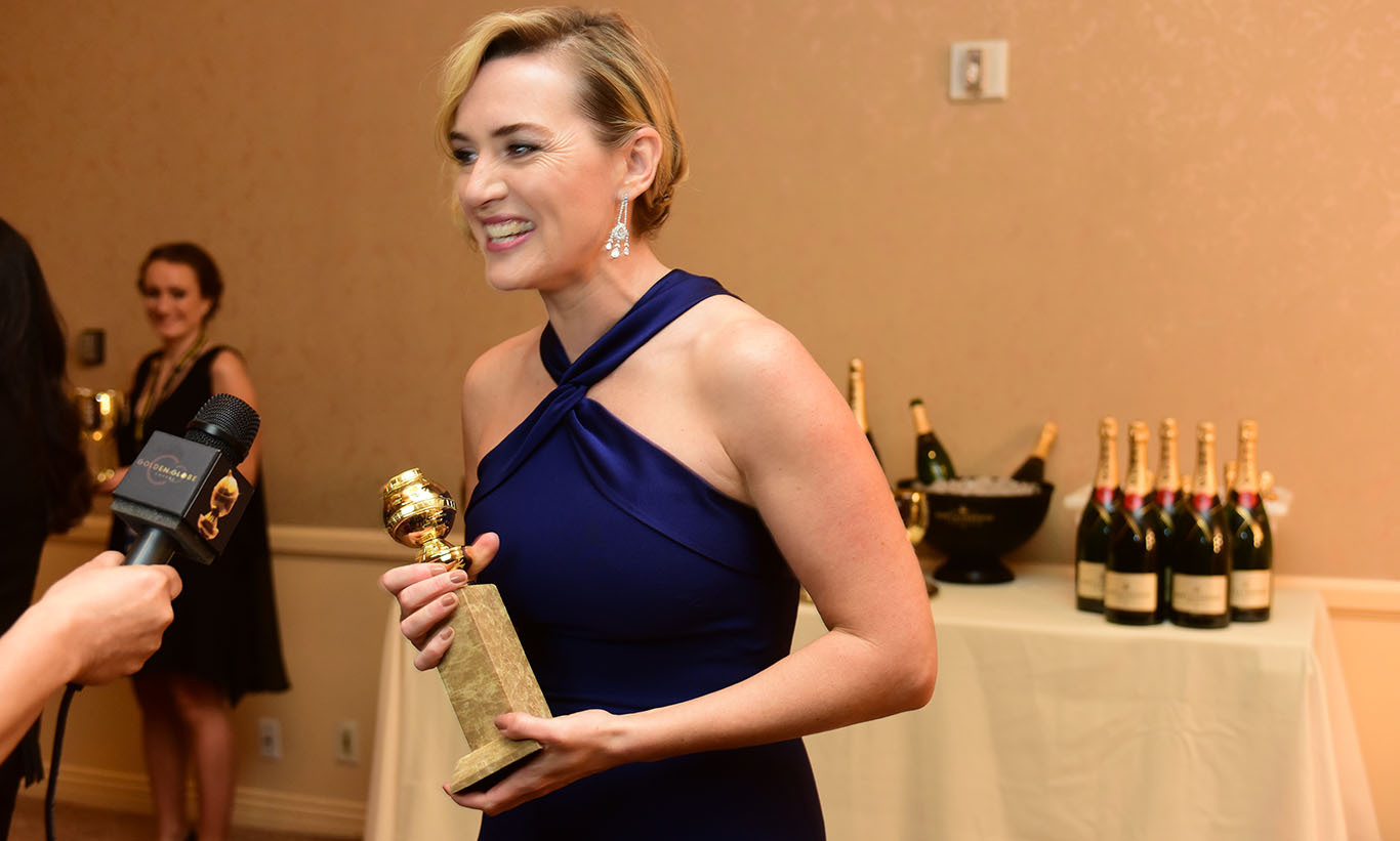 Look at that smile! Golden Globes winner Kate Winslet toasted with Moët & Chandon backstage in the Winners' Lounge.