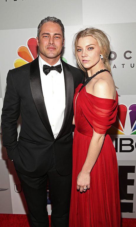 Taylor Kinney posed with Saoirse Ronan on the way into the Universal after party.