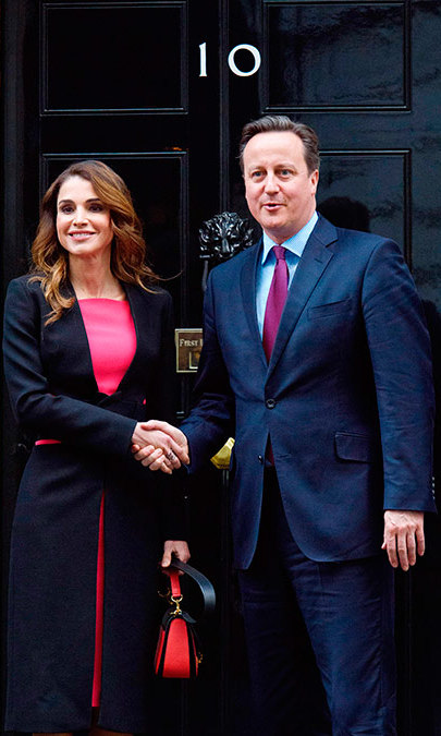 Outside the iconic No. 10 door of Downing Street in London, Queen Rania of Jordan meets British Prime Minister David Cameron to speak about the need for a comprehensive approach to the Syrian humanitarian crisis.<br>Photo: Getty Images