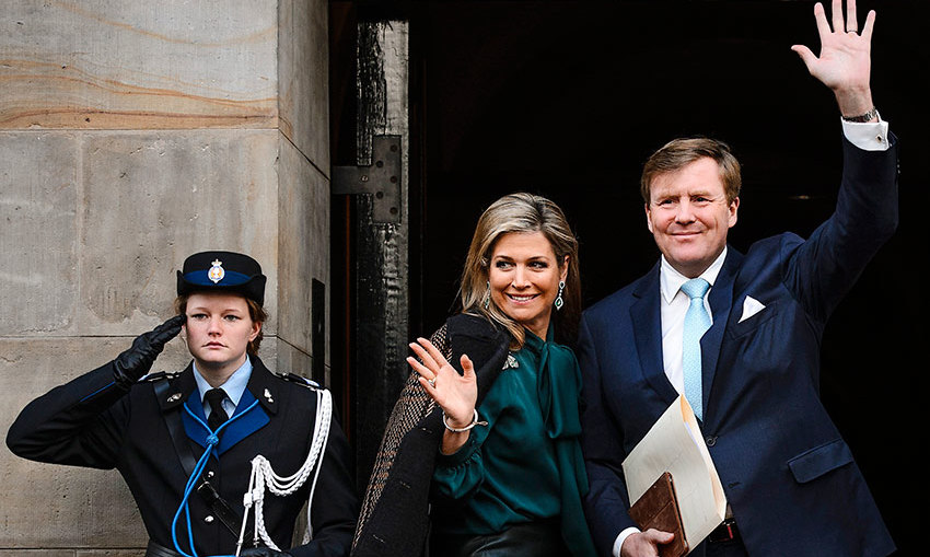 Elegant in emerald green, Queen Maxima and husband King Willem-Alexander of the Netherlands arrive for the traditional New Year's Reception at the Royal Palace in Dam Square in Amsterdam.