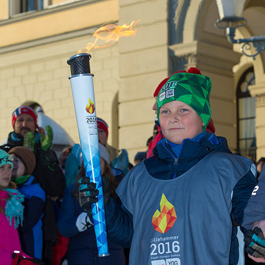 A very proud Prince Sverre Magnus carried the Olympic Torch, cheered on by his his parents Prince Haakon, seen left, and Princess Mette-Marit.