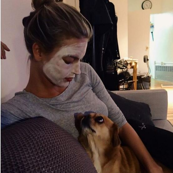 Face masks and a pup for Martha Hunt
