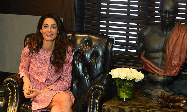 Amal wore a pink printed suit for a meeting in the Sri Lankan capital. 