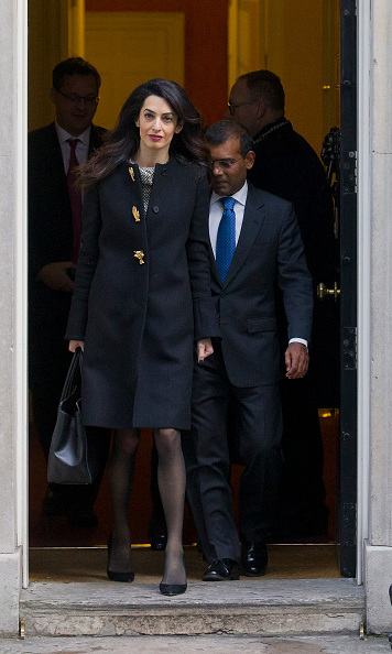 Sporting a sleek coat, Amal left a meeting with former British Prime Minister, David Cameron. 