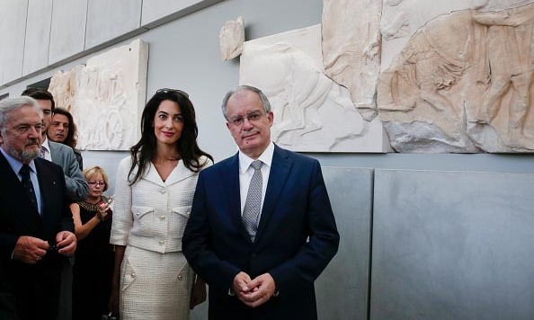 During a trip to Athens, Amal stunned in a cream-colored Chanel suit. 