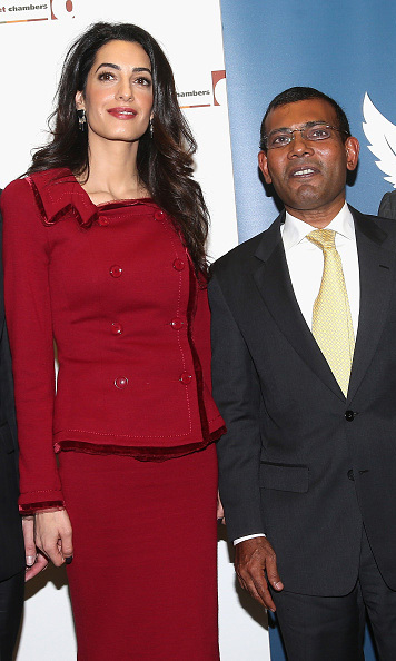 Lady in red! Amal stunned in a red skirt suit with President Nasheed of the Maldives.