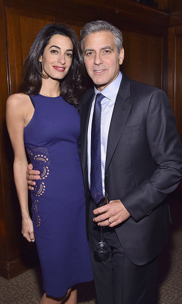Most stylish humanitarian!  Amal opted for a sleek blue dress during the 100 Lives Initiative with husband George Clooney. 