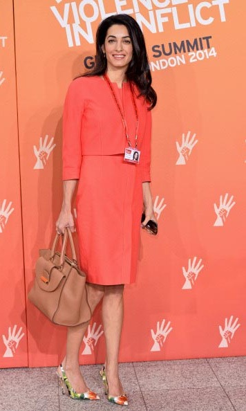 Dressed up for a cause! Amal wore a coral, Paule Ka dress for an appearance at the Global Summit To End Sexual Violence in Conflict in London.  