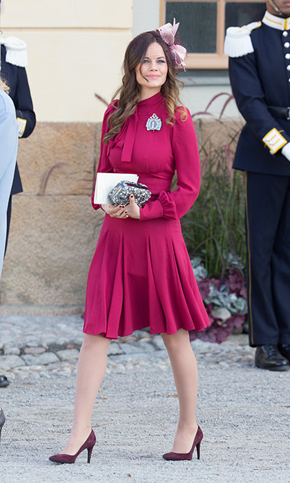 Pretty in pink! Royal watchers looked for a sign of a baby bump as the 31-year-old attended the Christening of Prince Nicolas of Sweden at Drottningholm Palace.