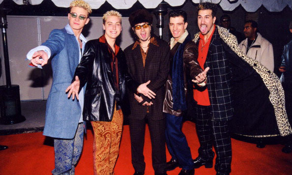 *NSync and in style! Justin (his frosted tips) and his former bandmates Lance Bass, Chris Kirkpatrick, JC Chasez and Joey Fatone rocked funky suits during the Billboard Music Awards in December 1998 in L.A. 