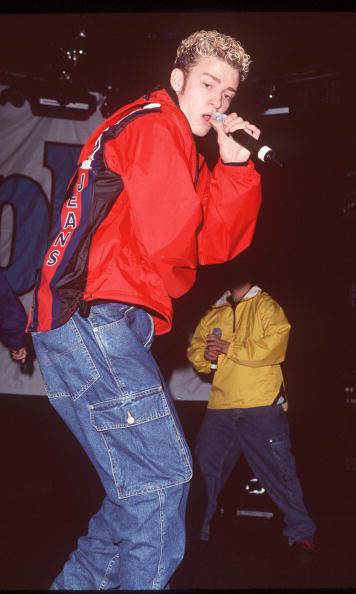 Windbreaker and cargo jeans never looked so good as on Justin in January of 1999. 