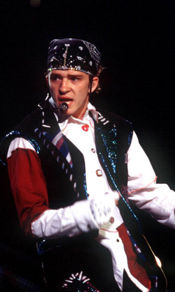 No String Attached! Instead of letting his curls fly during a performance at Walt Disney World in January 2000, Justin rocked the memorable bedazzled bandana with his circus-inspired concert attire. 