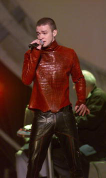 Curls no more. Justin showed off his buzz cut and all leather attire during the Grammy Awards in 2001. 