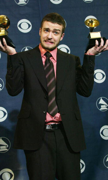 Suited up, with a reason to celebrate during the Grammy Awards in February 2004. 