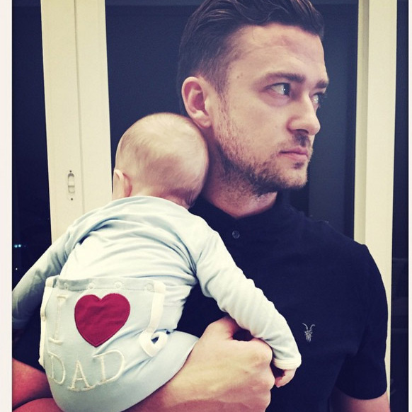 Daddy swag! JT pulled off his best look to date when he posted a picture from his first Father's Day featuring his son Silas Randall in June 2015. 