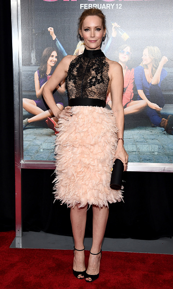 February 3: A lesson in style, and being single! Leslie Mann stunned in a Marchesa Chantilly lace cocktail with satin bow back ribbon choker and full feather skirt during the 'How to be Single' premiere in NYC.