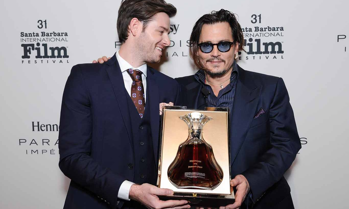 February 4: Quite the bottle!  Frank Larrazaleta, Prestige Range Brand Educator at Moët Hennessy USA, presented a bottle of Hennessy Paradis Impérial to actor Johnny Depp as he received the prestigious Matlin Modern Master award at the 31st Santa Barbara International Film Festival at the Arlington Theater in Santa Barbara, California.   
