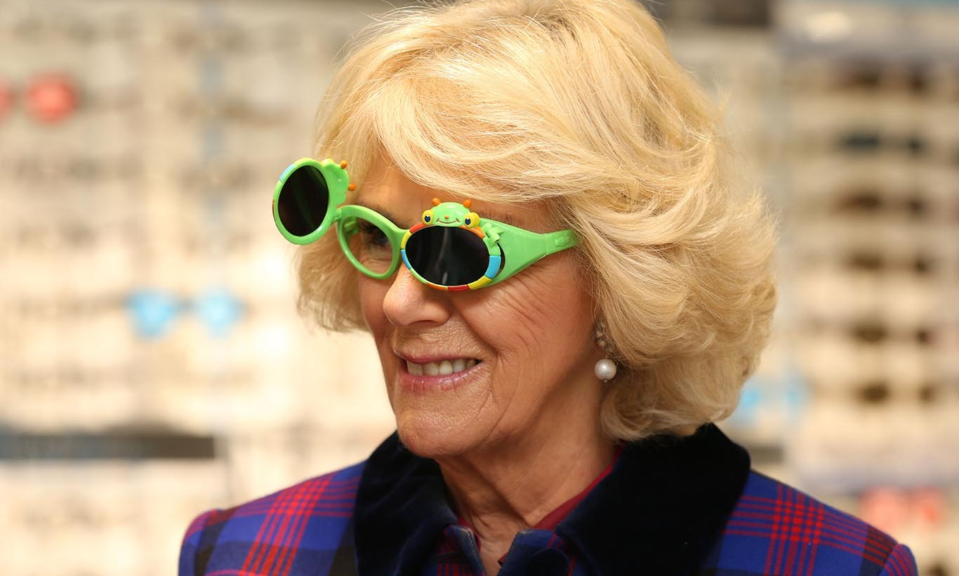 Camilla, Duchess of Cornwall had fun with a pair of green glasses at Boots Opticians in the United Kingdom. 