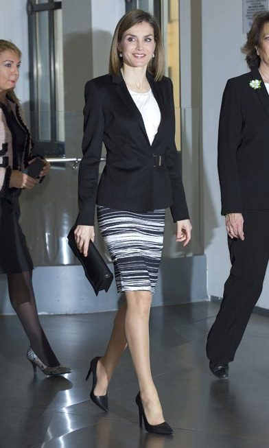 Queen Letizia of Spain stepped out in a BOSS Hugo Boss jacket and pencil skirt, and high heels by another of her favorite brands, Magrit at the Forum Against Cancer in Madrid.