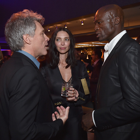 Seal and girlfriend Erica Packer chatted with host Jon Bon Jovi at the Vanity Fair Super Bowl Party.