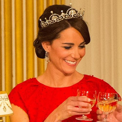 Channel your inner Duchess and don a tiara! Simply tie your hair back into a chignon or low bun. Then, place the tiara where the parting for your bangs begin. You'll instantly feel like a royal.