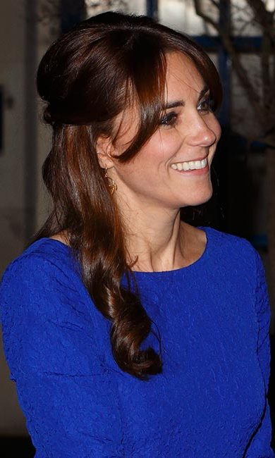 Get this sweet look by dividing your bangs into two sections: front and back. Then, brush the back section into the rest of your hair. Leave the front stands loose to get the soft look that Kate had. 