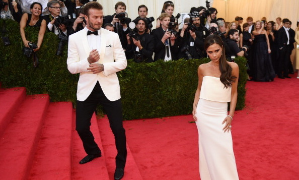 Quite possibly the most handsome couple out there, Victoria Beckham slays the red carpet as David Beckham looks on. 