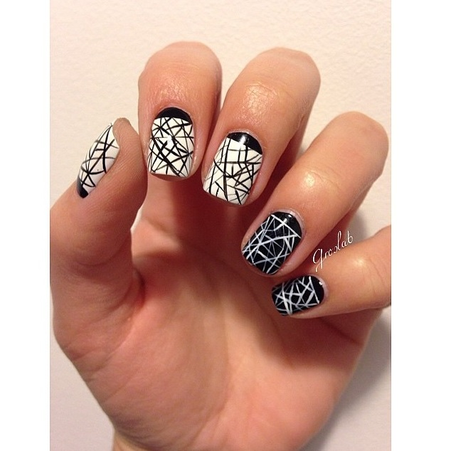 Edgy chic! This monochrome mani is great for an edgy look.