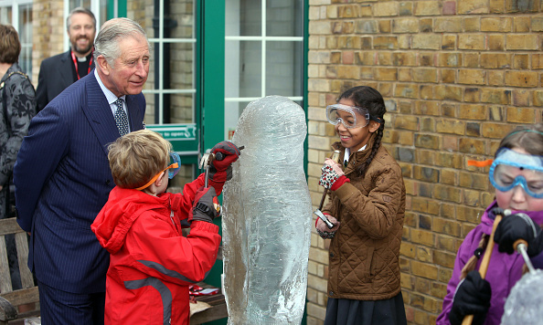 Prince Charles checked out an ice sculpture made by students at Ashley Primary School in Walton-on-Thames, England.