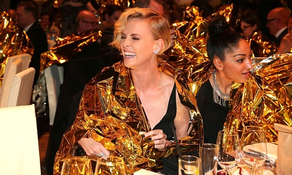February 15: Covered in gold! Charlize Theron was all smiles during an appearance at the 2016 Cinema for Peace Gala during the 66th Berlinale International Film Festival in Berlin. 