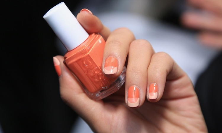 "For Rebecca Minkoff's 2016 presentation, Michelle Saunders for essie created a warm, coral ""tone on tone"" nail design, which was inspired the modern music girl. 