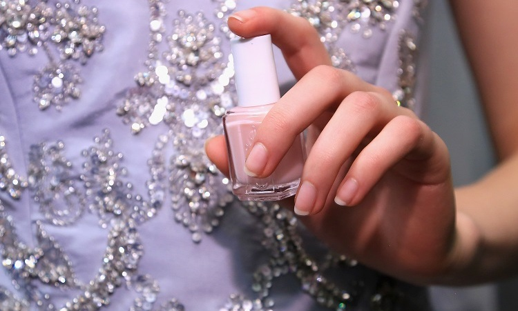 "To compliment Peter Copping's third collection for Oscar de la Renta, Michelle Saunders for essie created a well-groomed ""vintage glow"" manicure using a color palette that included French blue, oyster, bordeaux, dusty rose and black.