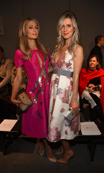 Inside, at the Pamella Roland show, she was joined by future aunt Paris Hilton, who also wore the designer.