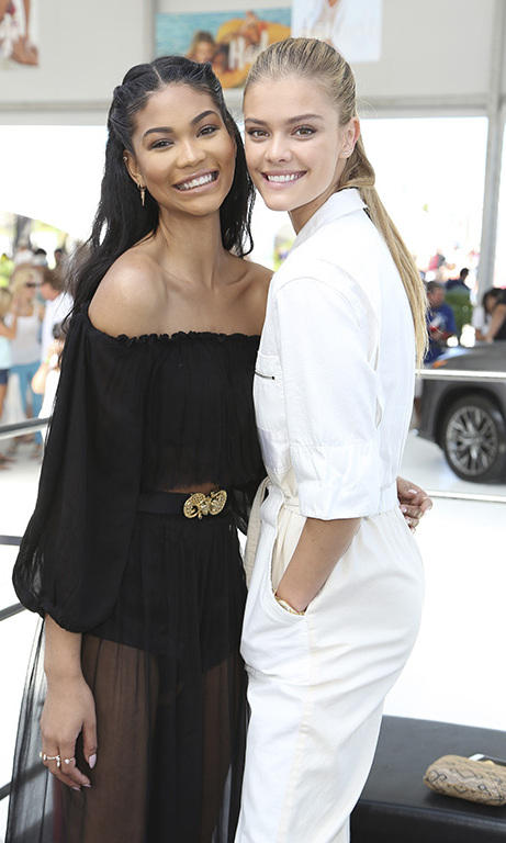 "February 17: Swimsuit ready! Chanel Iman and Nina Agdal took in the Miami heat at the 1 Hotel South Beach during the Sports Illustrated ""Swim Beach"" fan festival. 