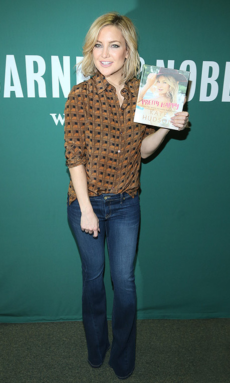 February 16: Pretty happy! Kate Hudson was all smiles during the signing for her new book 'Pretty Happy: Healthy Ways to Love Your Body' at Barnes & Noble in NYC. 