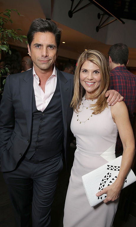 "February 16: Have mercy! John Stamos and Lori Loughlin posed for the perfect ""Katsopolis"" couple photo during Netflix's 'Fuller House' premiere at The Grove in L.A.