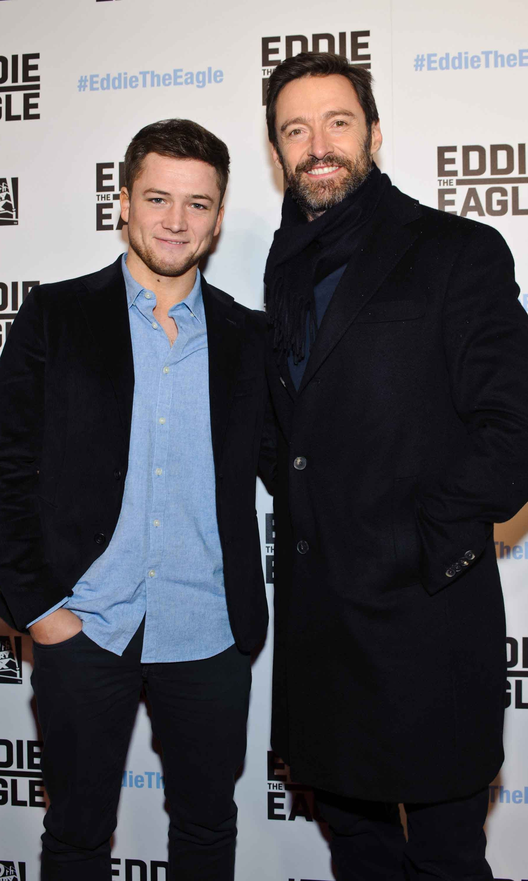 February 16: Two handsome men! Taron Egerton and Hugh Jackman attended the 'Eddie the Eagle' screening in Chicago. 