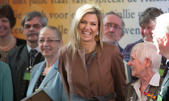 Queen Maxima of The Netherlands turned on her famous mega-watt smile as she mingled with volunteers at charity Schulhulpmaatje in Leiden.