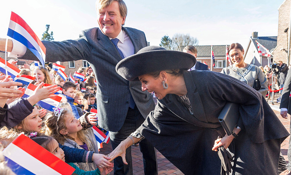 Queen Maxima and King Willem-Alexander of the Netherlands shook hands with some young fans during their visit to Sprundel in the Netherlands.