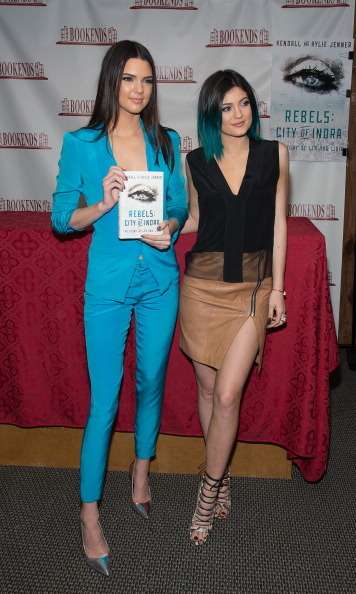 Remember when the youngest Jenners released their own book? Here they are at a book-signing event. Kendall dazzled in a sky blue suit while Kylie donned a tan zip-up skirt.