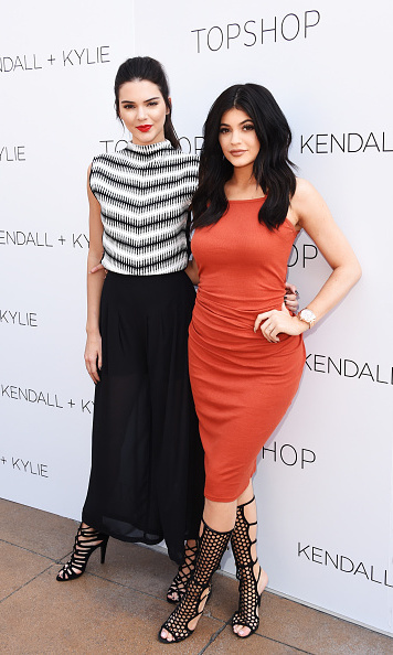 At the launch of their line with Topshop, Kendall and Kylie donned similar pairs of heels. Kendall chose a monocrome color scheme. Kylie, with a form-fitting dress, looked like older sis Kim Kardashian more than ever.