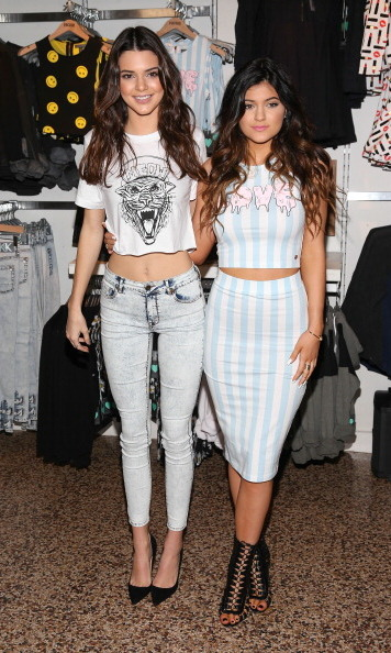 The pair posed for a snap together at the launch of their 2013 holiday collection with PacSun. Kylie rocked her signature two-piece look while Kendall stayed casual in a cropped tee and jeans.