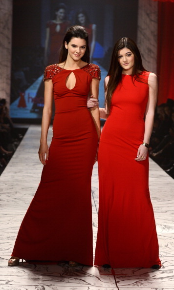 Kendall and Kylie looked very mature in these classic red dresses for a 2013 fashion show.