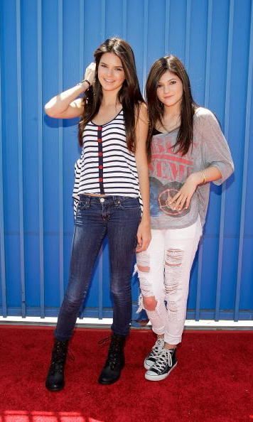 Kendall and Kylie moved gracefully into their teens by 2010. Kendall donned combat boots, a wardrobe essential for any teenage girl, while Kylie rocked the ripped jeans and Converse look.