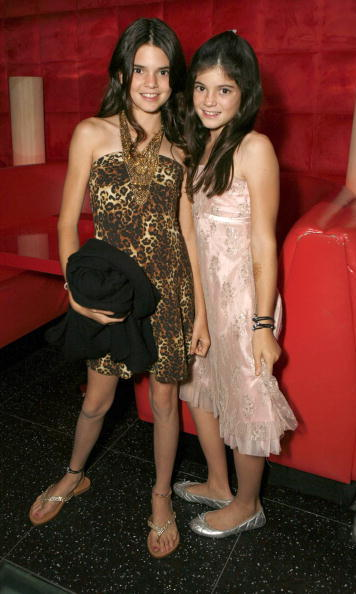 One of the sisters' early public appearances at a screening of <i>Keeping Up with the Kardashians</i> in 2007. Kendall chose to channel her wild side with the cheetah print while Kylie kept it classic with a sweet pink print dress.