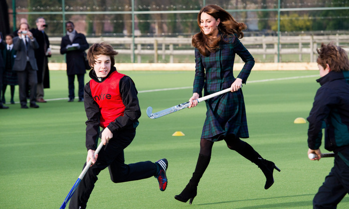 Kate traded sneakers for a pair of stylish black boots while playing a game of hockey during St. Andrew's Day at St. Andrew's School in 2012.
