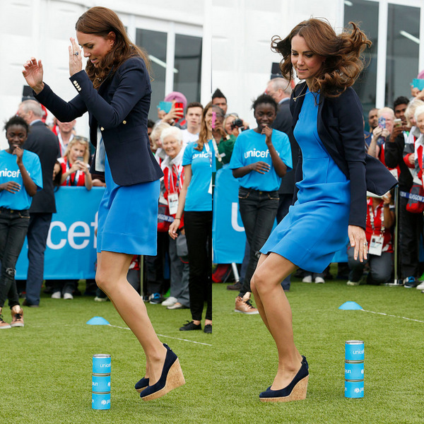 Go ahead and jump! Kate took a cue from Van Halen and jumped (in wedges again!) while playing the South African game of Three Tins during a visit to the Commonwealth Games Village in 2014.