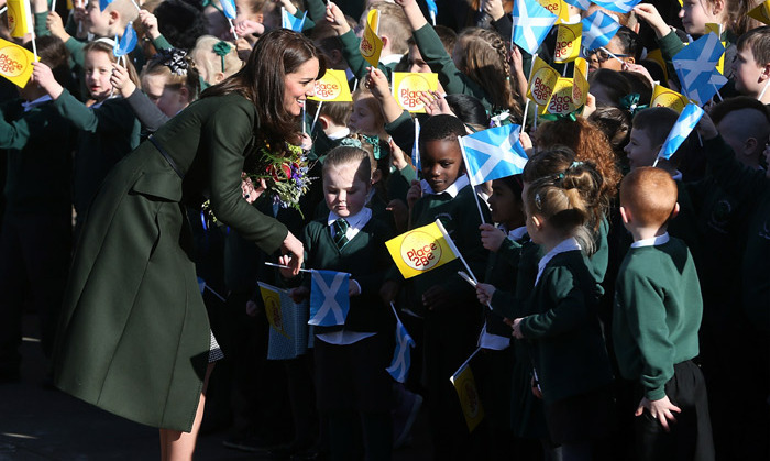 Upon leaving the school, Kate stopped to chat with children that had waited in the cold to meet her.